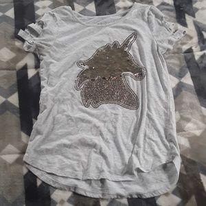 A shirt that has a flip sequin unicorn.